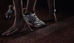 Sport. Runner. Hands on starting line. Close view